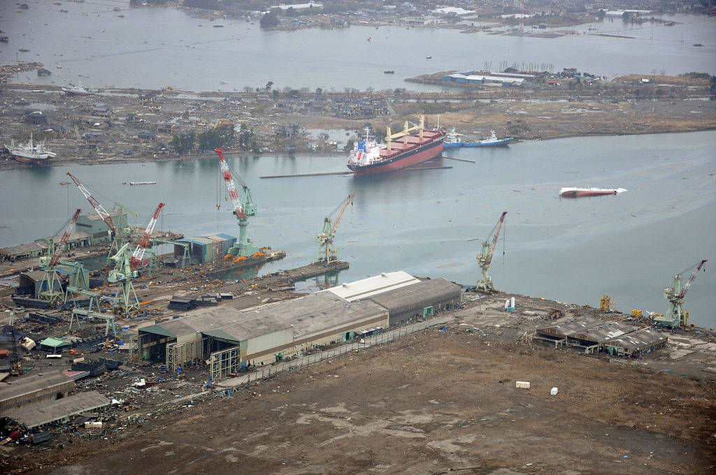 US_Navy_110320-N-OB360-166_An_aerial_view_of_ships_washed_ashore_and_overturned_at_a_port_near_the_Japan_Air_Self-Defense_Force_Matsushima_Air_Base